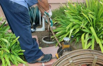 a worker providing septic tank inspection